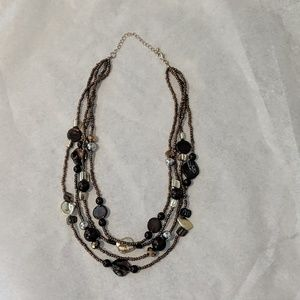 Brown and gold tone multi-strand necklace